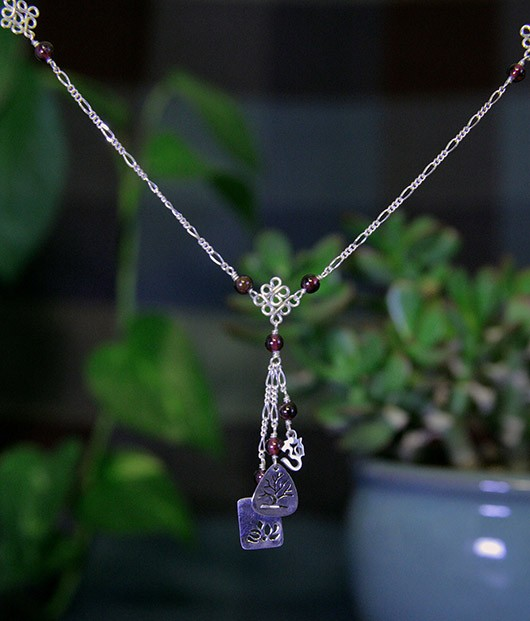 Sacred Symbols Necklace with Garnet