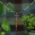The HeartRise Chakra Necklace